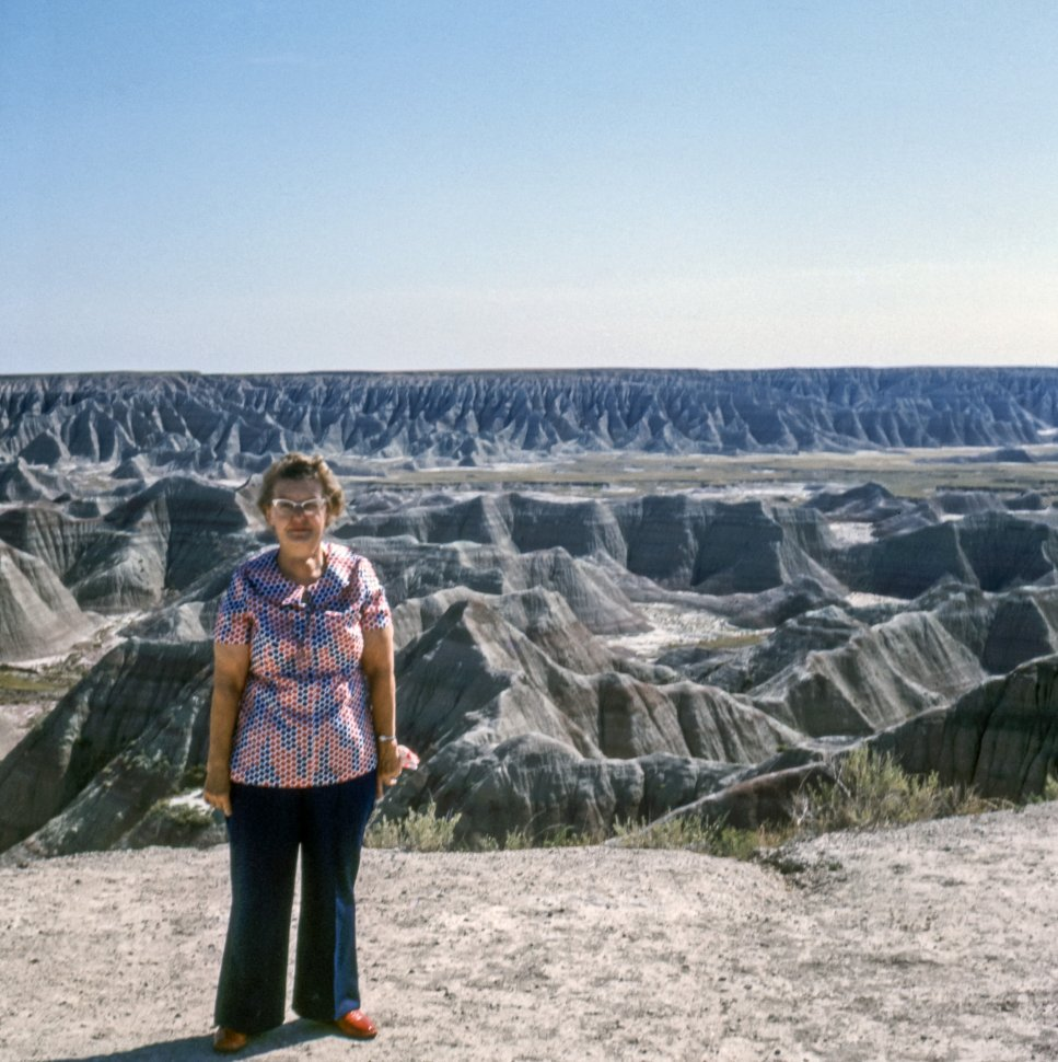 Free image of Woman posing in front of Badlands National Monument, South Dakota, USA