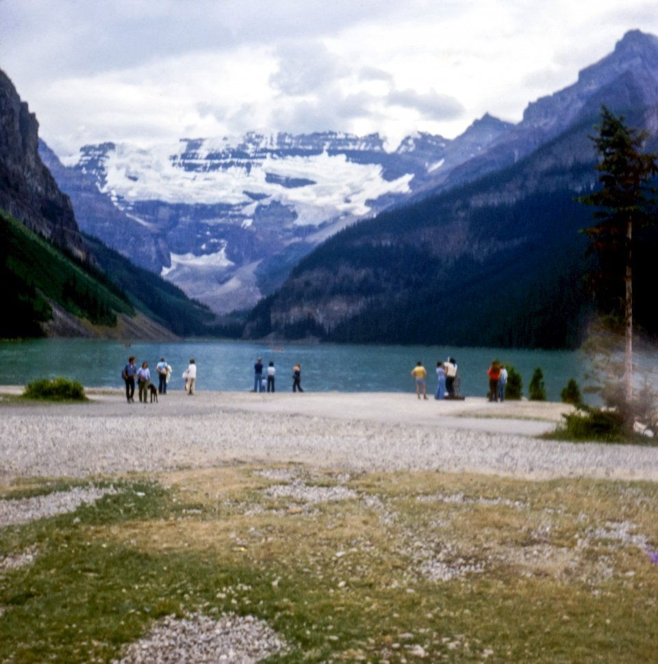 Free image of Tourists standing in front of a glacial lake and moutain, Banff National Park, Canada