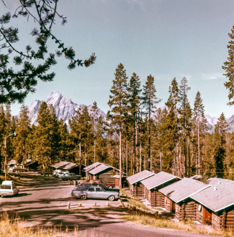 Free image of Mountain cabins and peaks in the distance, USA