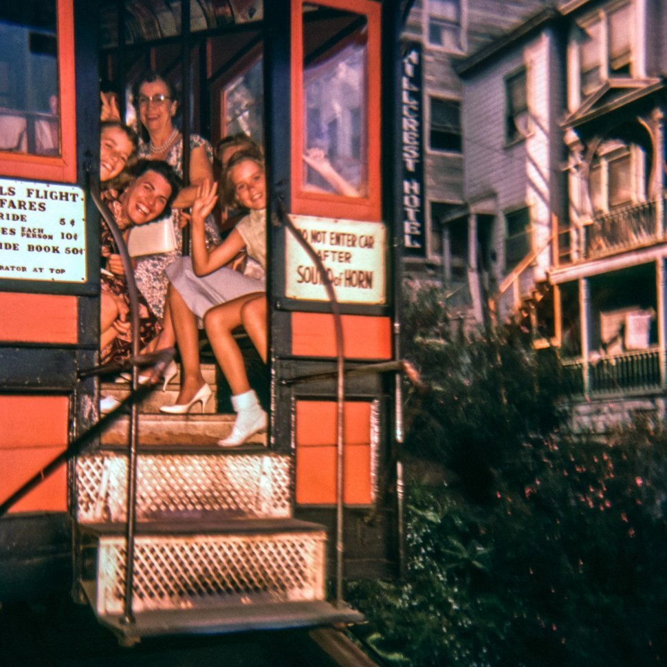 Free image of Women smiling and waving from Angel s Flight ride on a city cliffside, Los Angeles, California, USA