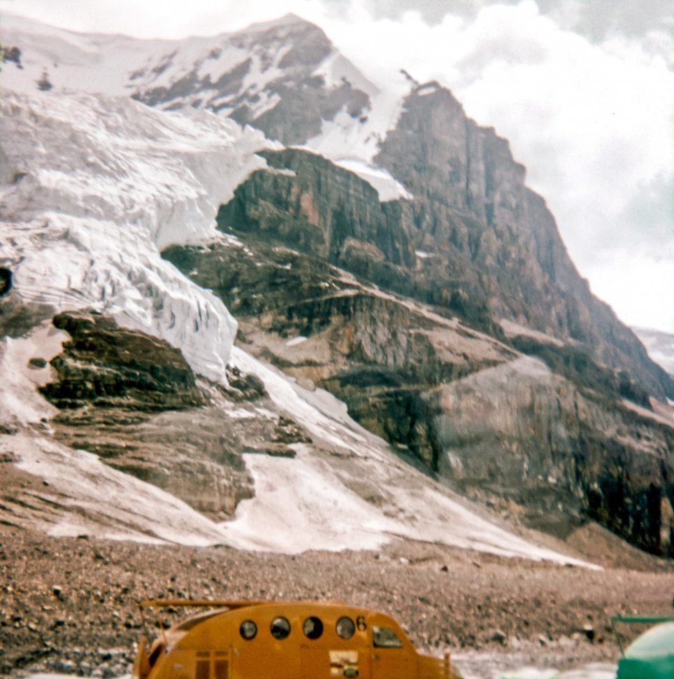 Free image of Half-track below mountains and glacier, Canada