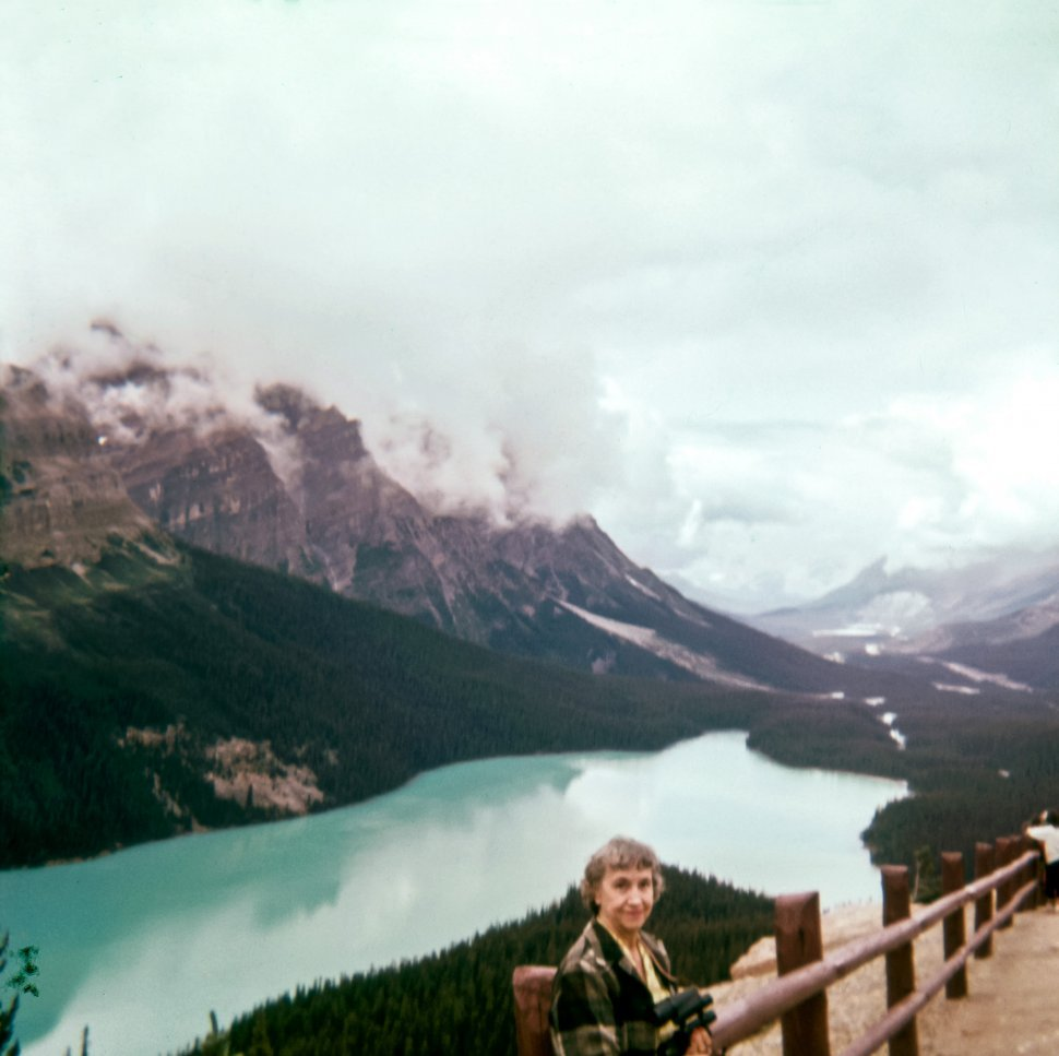 Free image of Woman posing above a mountain lake, Europe