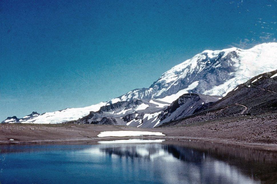 Free image of Snow on mountain range with mountain lake.