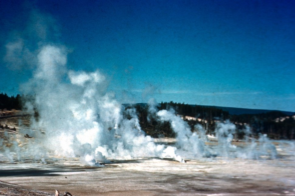 Free image of Yellowstone National Park with steam rising from geysers, Wyoming, USA
