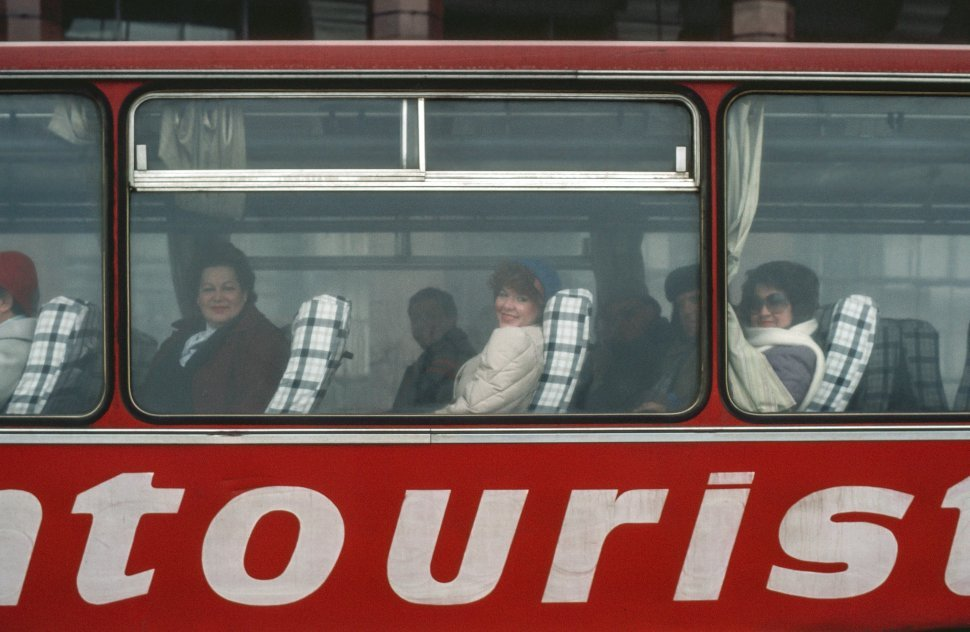 Free image of People looking out from window of tourist bus in USSR