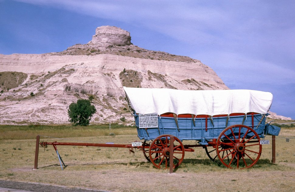 Free image of Conestoga wagon, Prarie Schooner near rock mountain