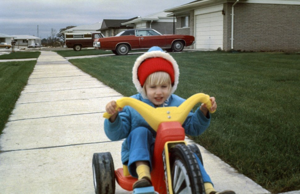 Free image of Child playing outdoor on tricycle