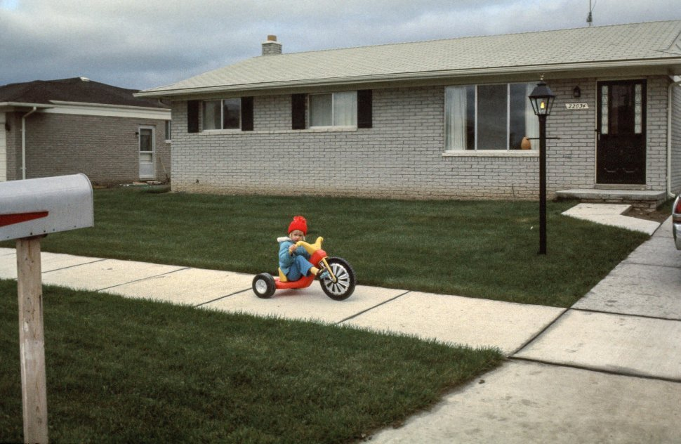 Free image of Three-years-old child playing outdoor on tricycle