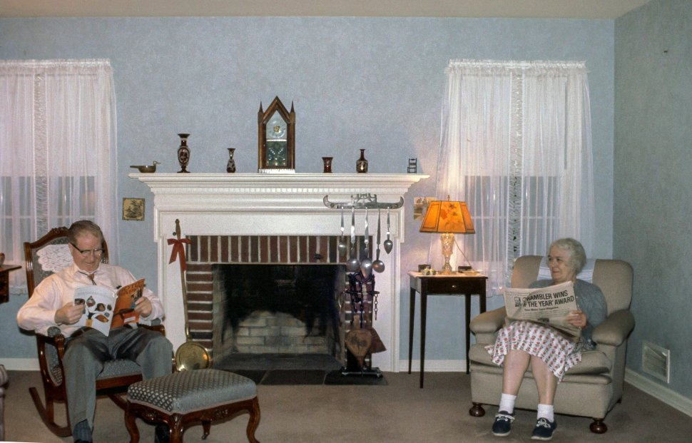 Free image of Old-aged couple reading in the drawing room