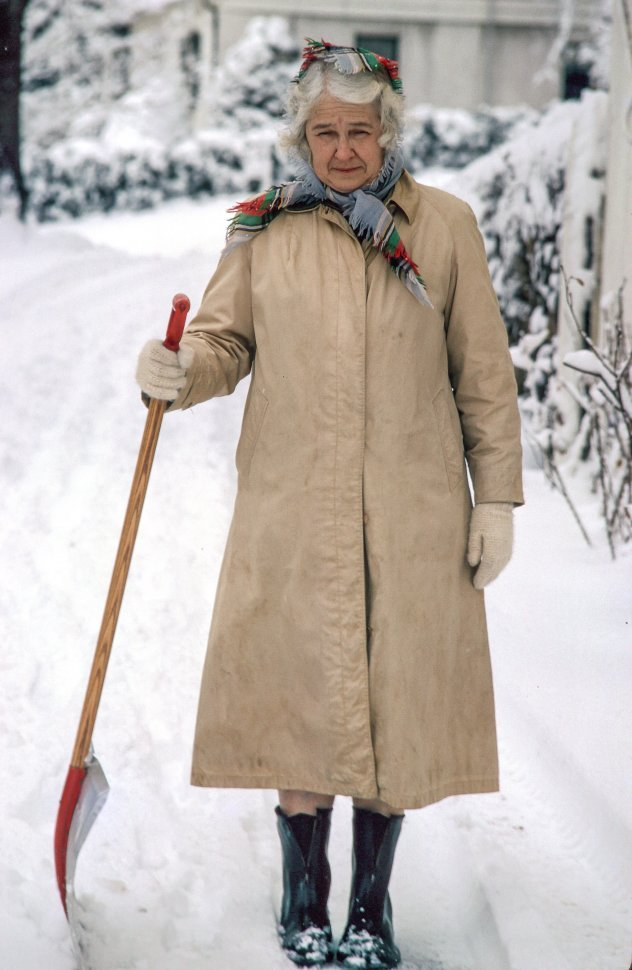 Free image of Elderly Woman Standing and Holding Shovel In the Snow