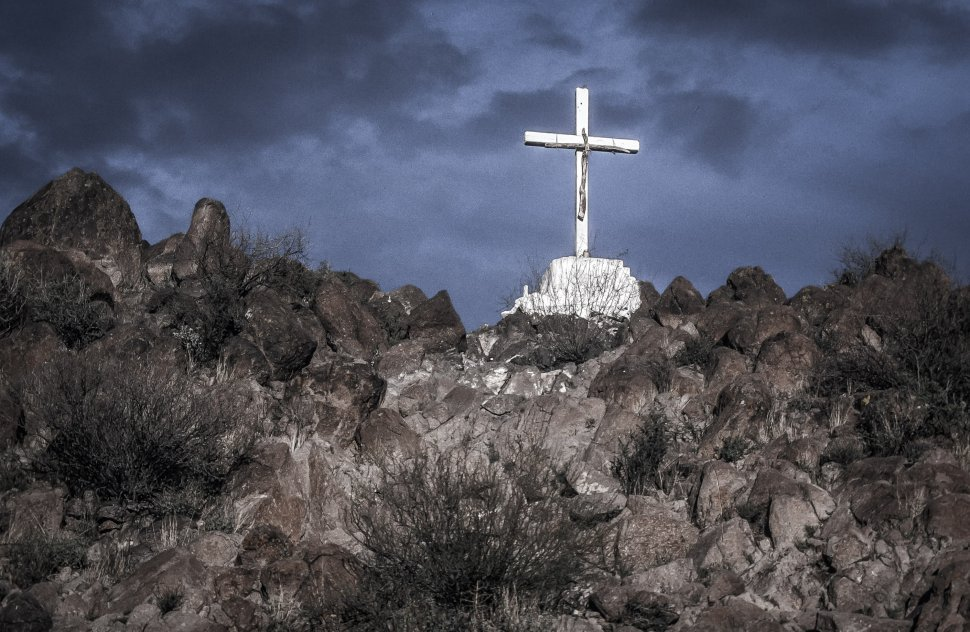Free image of White cross on Grotto Hill above Mission San Xavier del Bac in Tucson Arizona