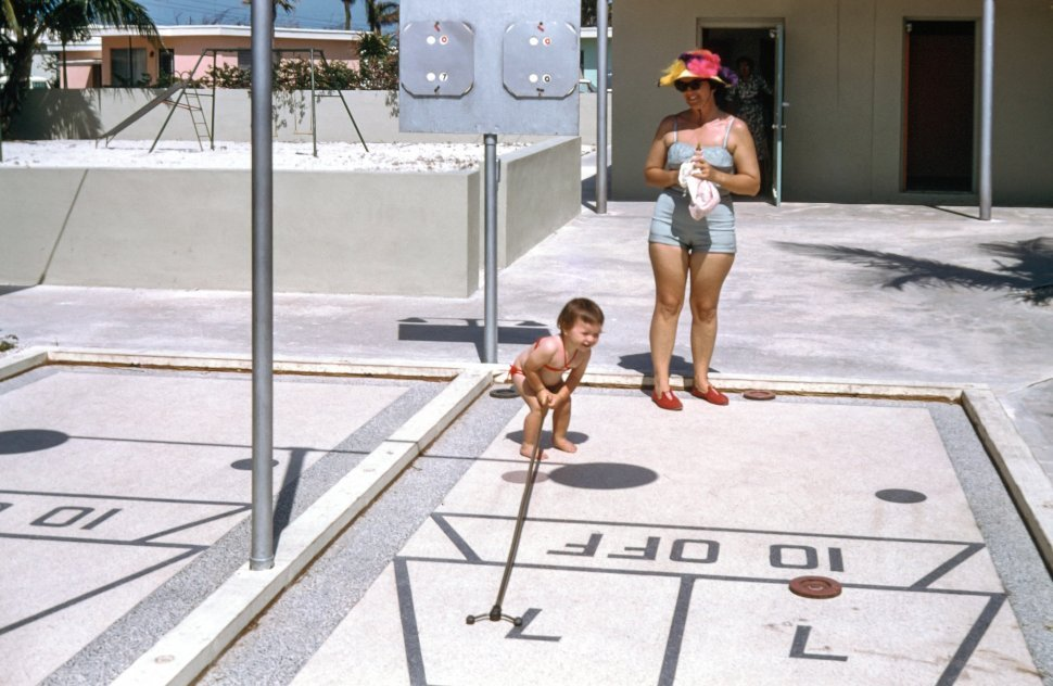 Free image of Mother and Child playing outside their house