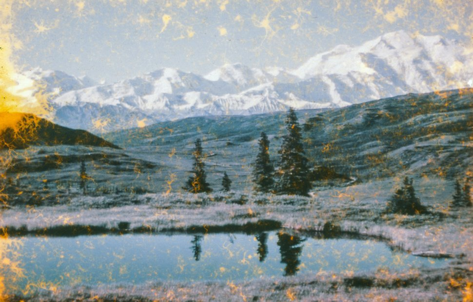 Free image of Scenic View Of Pond Against Snow Capped Mountains