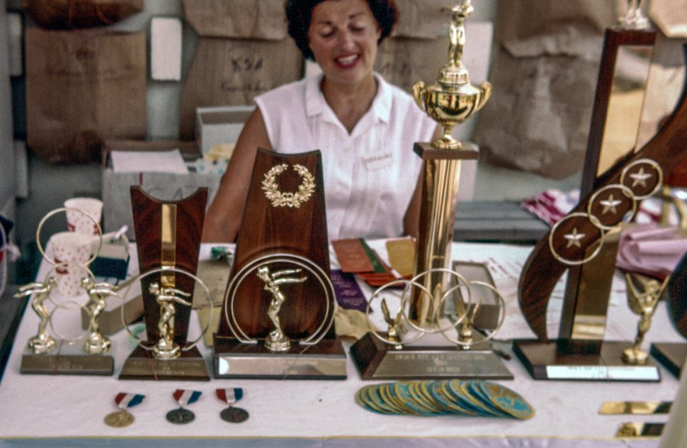 Free image of Woman showing Trophies and Medals