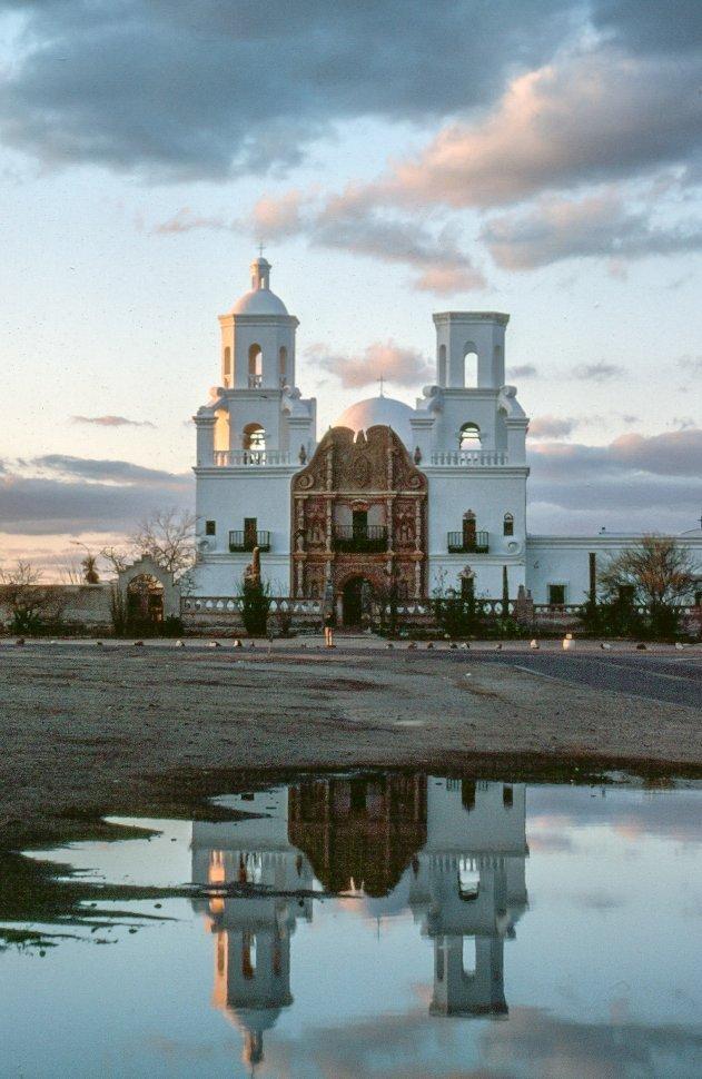 Free image of Reflection of San Xavier del Bac on Puddle in Tucson, Arizona, USA