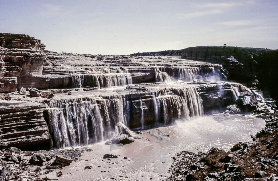 Free image of Water cascades down wide falls