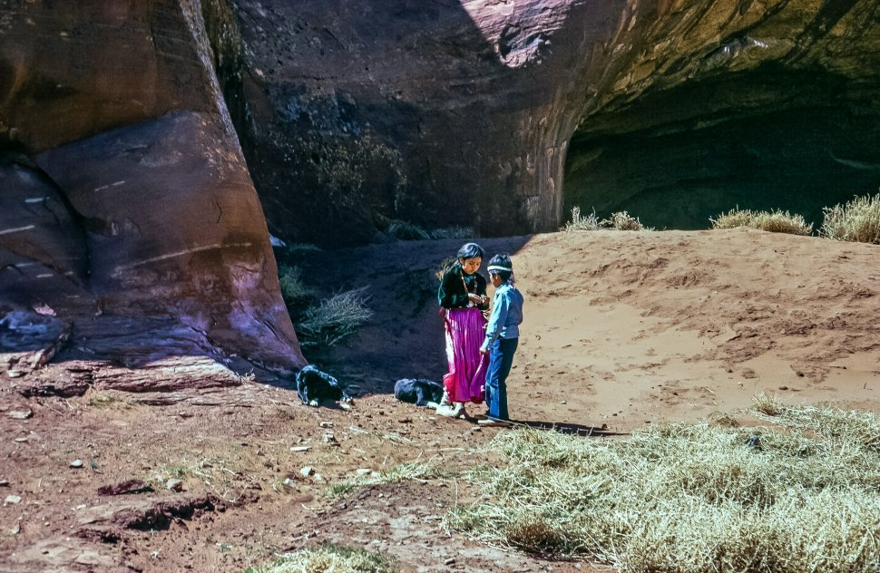 Free image of Two children of native american tribe outside Ear of the wind monument in Arizona