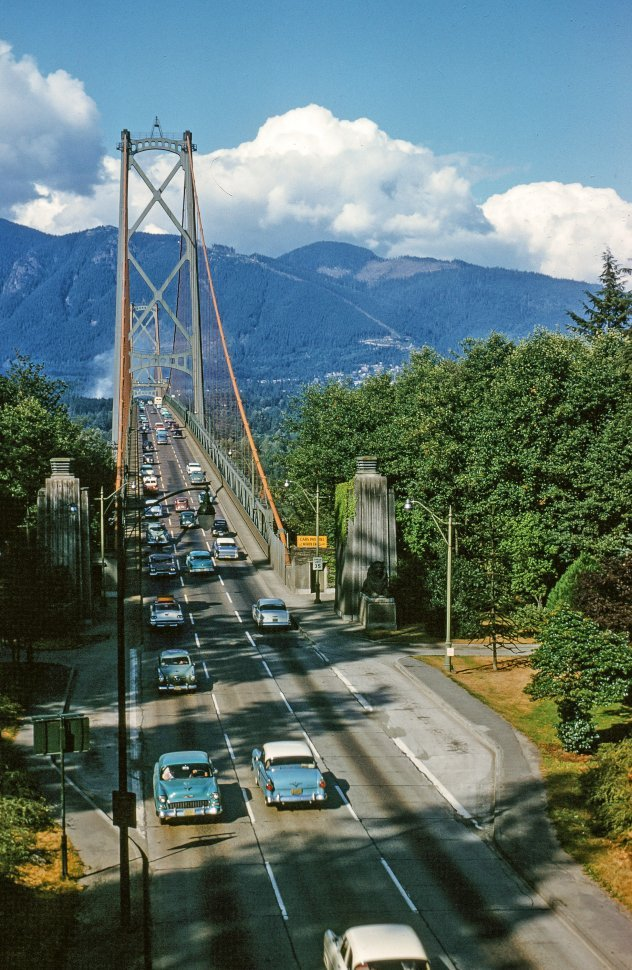 Free image of A high angle view of automobile traffic moving across the Lions Gate Bridge