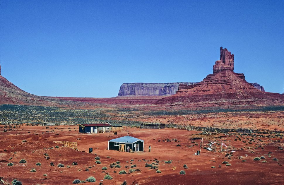 Free image of View of Native American Houses with Monument Valley Navajo Tribal Park in the background