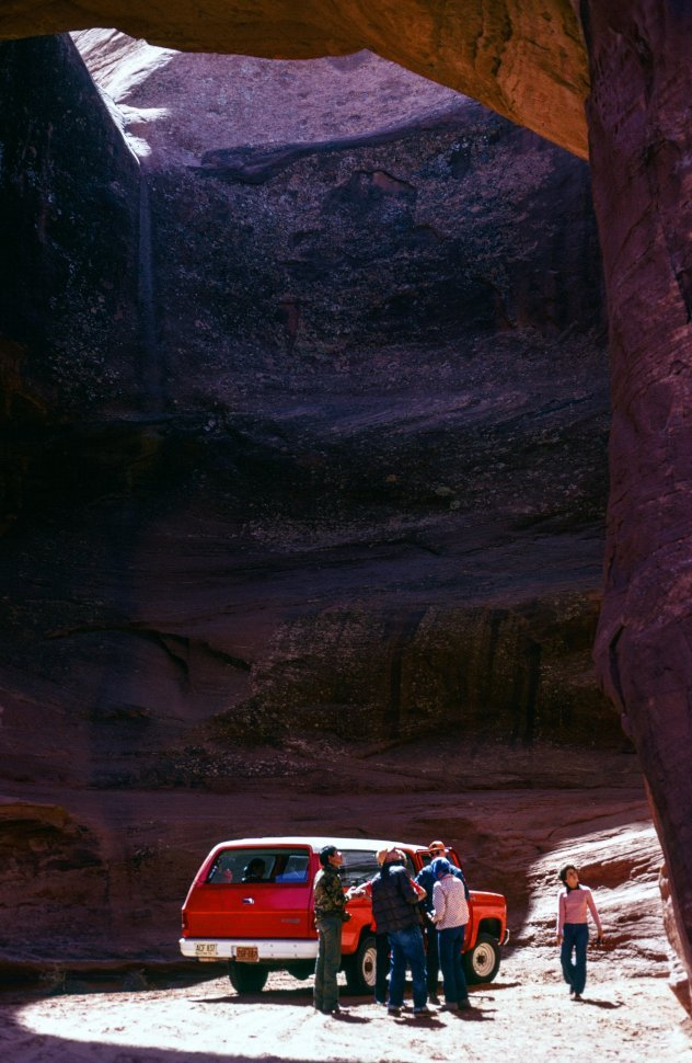 Free image of Group of Tourists in a tour viewig a slot canyon wall