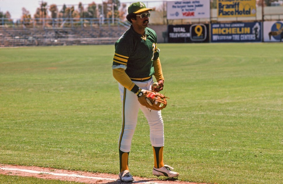 Free image of Reggie Jackson playingholding a baseball in Oakland