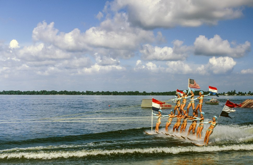 Free image of Group of water ski riders making pyramid with flags in Florida