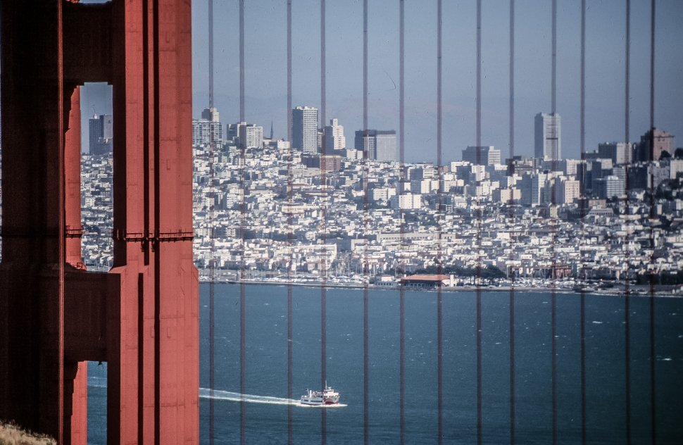 Free image of San Francisco skyline viewed through Golden Gate bridge cables