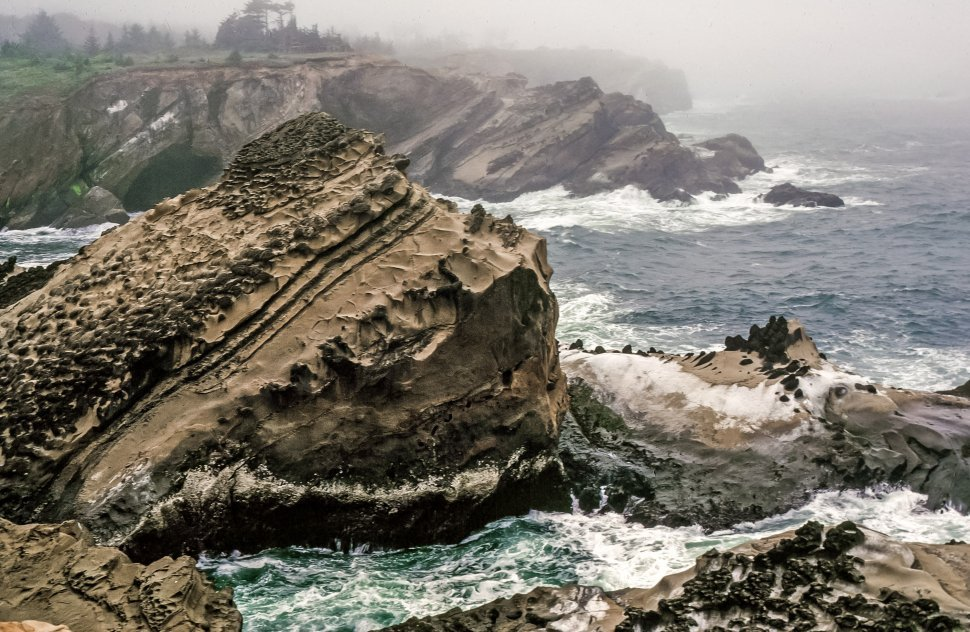 Free image of View of rocky shores and sea crashing