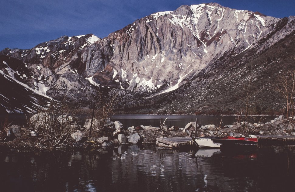 Free image of View of river as snow dotted mountains in the background